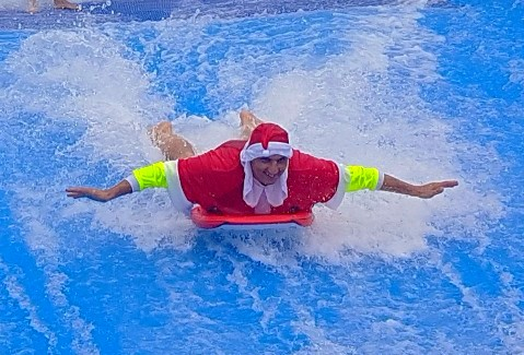 Mayor of Fairfield, Frank Carbone, on the wave rider in a Santa-suit.