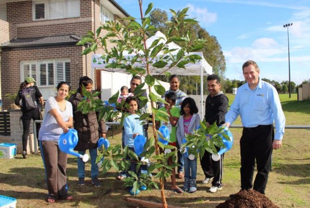 Mayor Bali planting street trees with Blacktown residents.