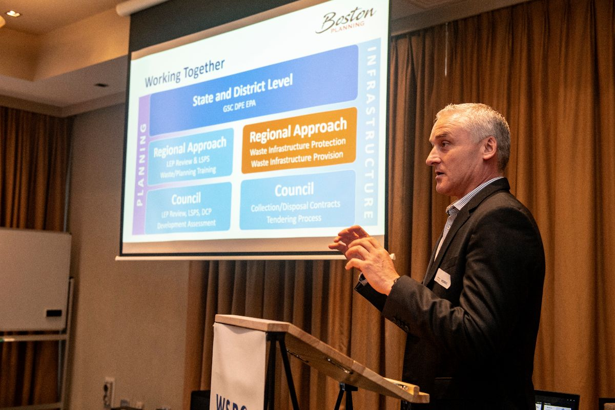 Consultant speaking at WSROC Waste event in front of screen
