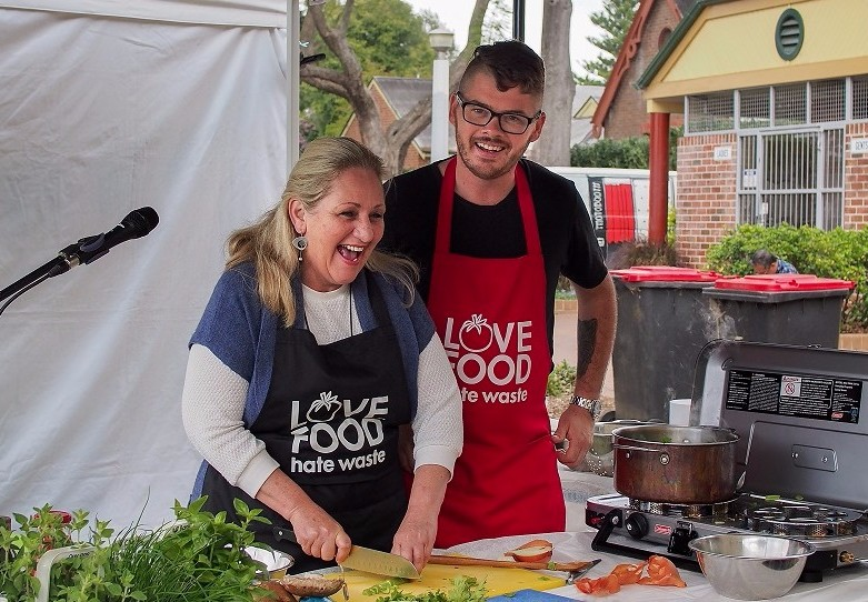 Hawkesbury Mayor, Mary Lyons-Buckett, cooking with Shop.Cook.Save chef, Jay Huxley at the Richmond Markets.