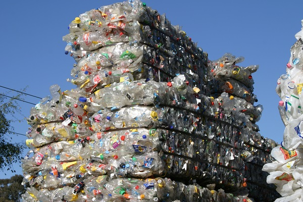Stacked plastic bottles ready for recycling.