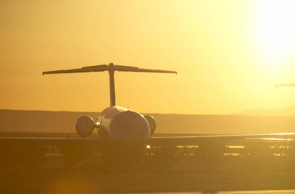 Aeroplane landing at sunset.
