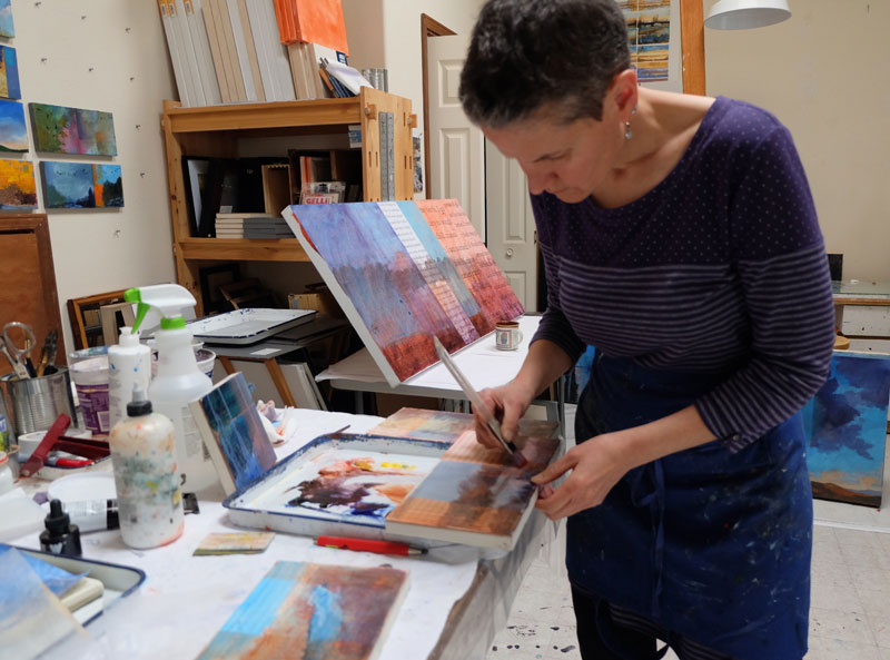 Santa Fe artist Dawn Chandler working with mixed media to create her textual landscape paintings