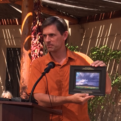 New Mexico Senator Martin Heinrich receives painting by Dawn Chandler