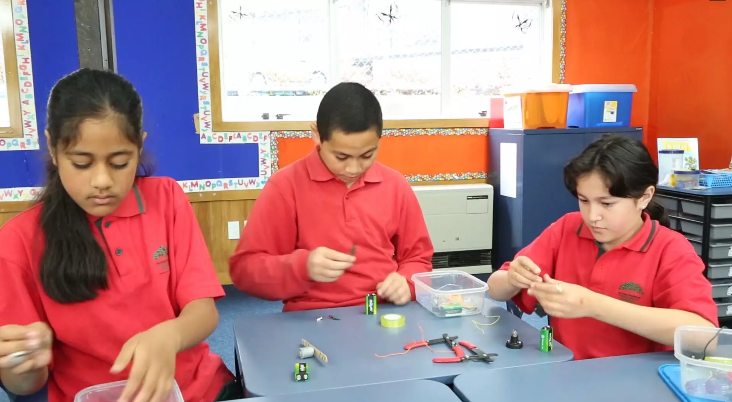 Students creating electrical circuits