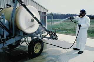 Cleaning a pesticide sprayer