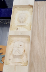 3D machining of Einstein and Darth Vader out of wood.