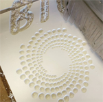 Swirl of circles being cut out of PVC with a ShopBot.
