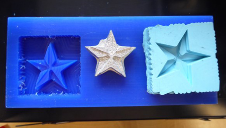 Metal star phases. First carved into wax with a ShopBot. A mould was then created from that carving and metal poured into it for casting.