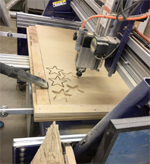 Cutting stars out of wood on a ShopBot.