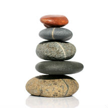 A pile of 5 different stones balanced one on top of the other