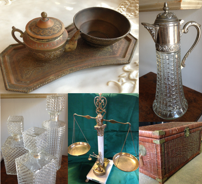 Recently salvaged beautiful items, like a tiny bronze tea set, a vintage caraf, a set of deco decanters, a vintage brass scale, and a beautiful woven chest.