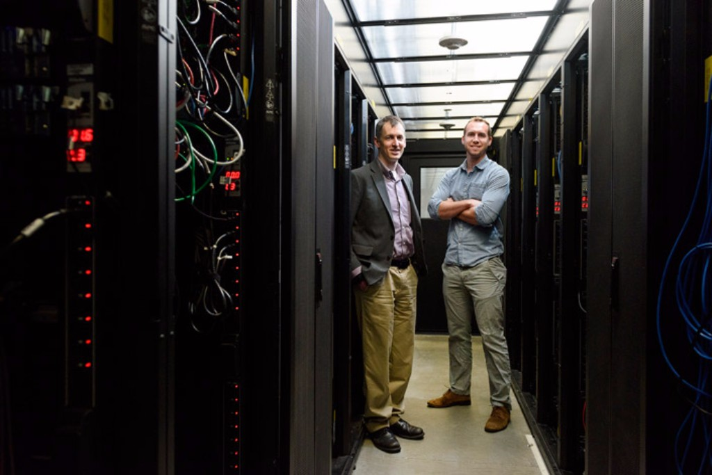 Evan Reed, assistant professor of Materials Science & Engineering at Stanford, and graduate student Austin Sendek are using artificial intelligence to develop safer batteries. Credit: L.A. Cicero