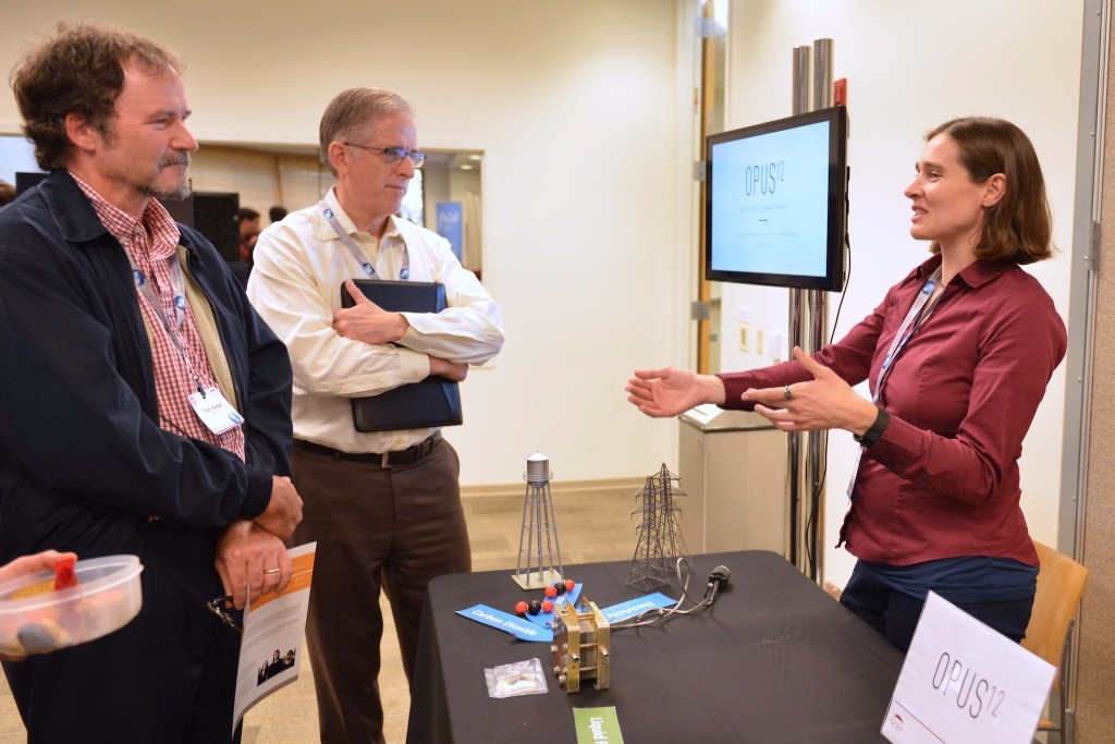 Kendra Kuhl of Opus 12 talks with visitors at the Stanford Energy Startup Showcase. Credit: Bill Rivard