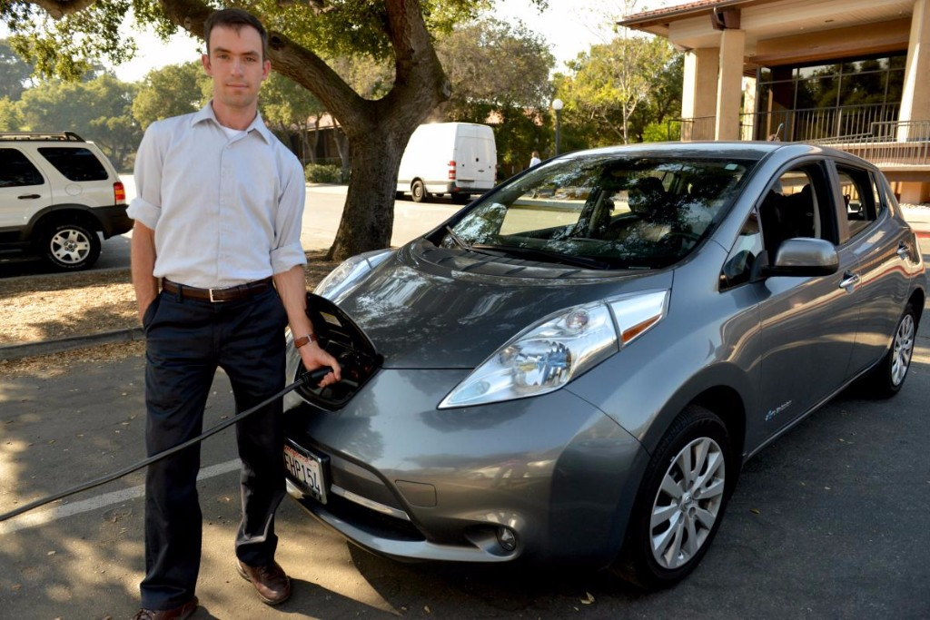 Matthew Pellow charges his all-electric Nissan Leaf. Credit: Mark Shwartz/Precourt Institute for Energy