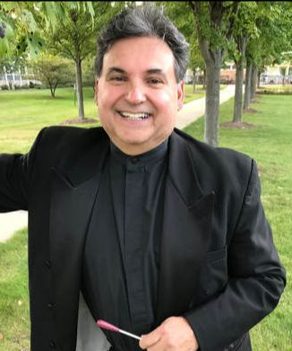 Dr. Louis Mechaca