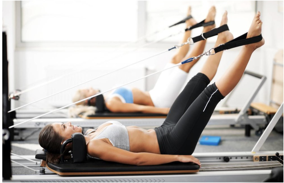 """""""Women working out on Pilates reformer"""