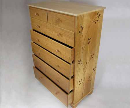 carved cherry and maple dresser