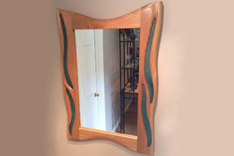 carved cherry mirror with copper inlay