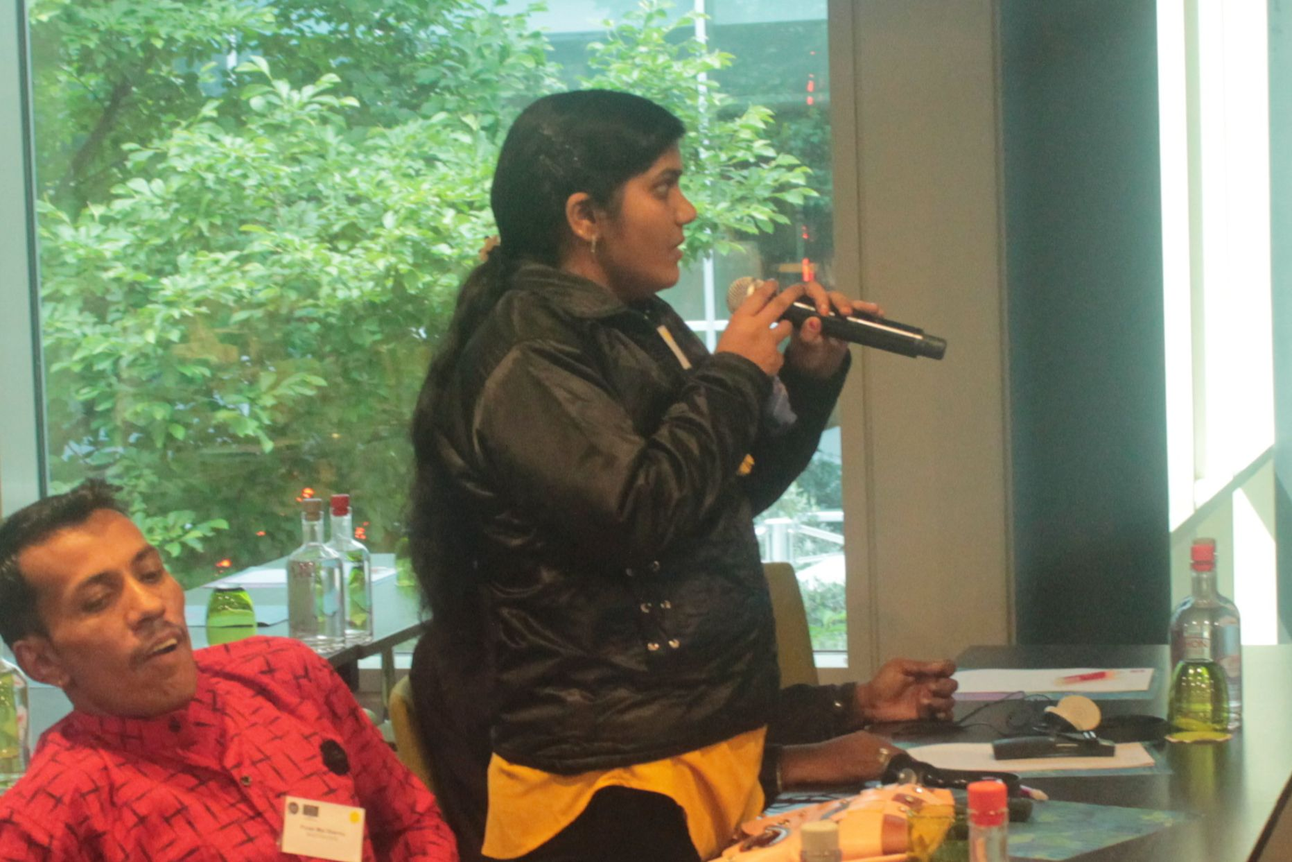 Neeta speaking into a microphone at the EDF general assembly
