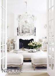 What living room with white furnishing and accessories