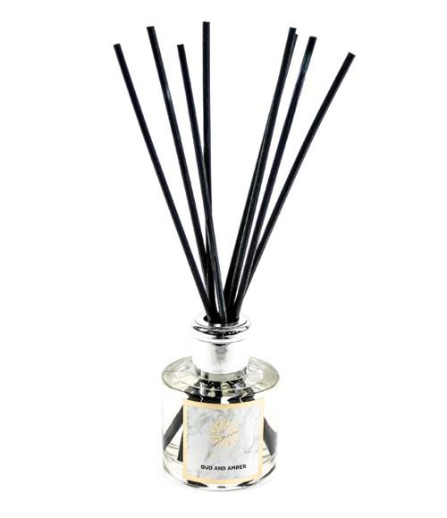 A Nuhr Home diffuser with rattan reeds