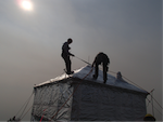 Fire fighters wrapping a structure