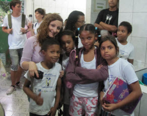Romanian singer with children in the favela