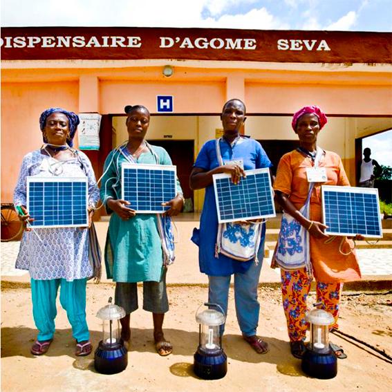 Tongolese women holding solar panels