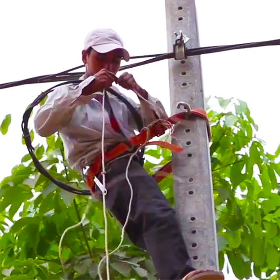 electrician trained in local rural distribution in Cambodia