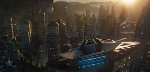 an image of the skyscrapers of Wakanda with the sun setting behind the mountains