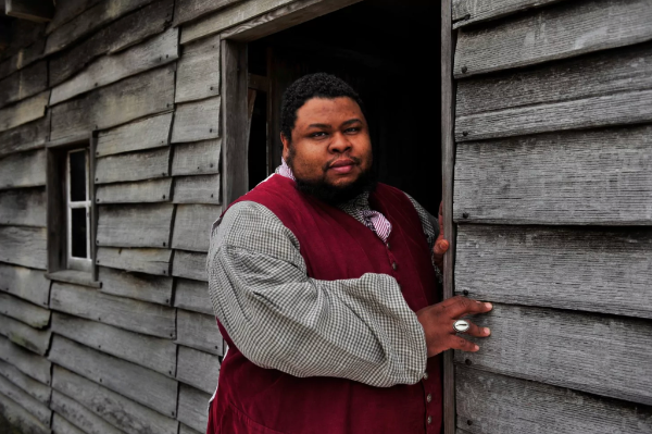 a photo of Michael W. Twitty in period clothing
