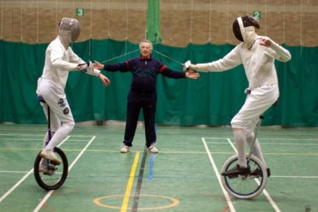 Two fencers on unicycles