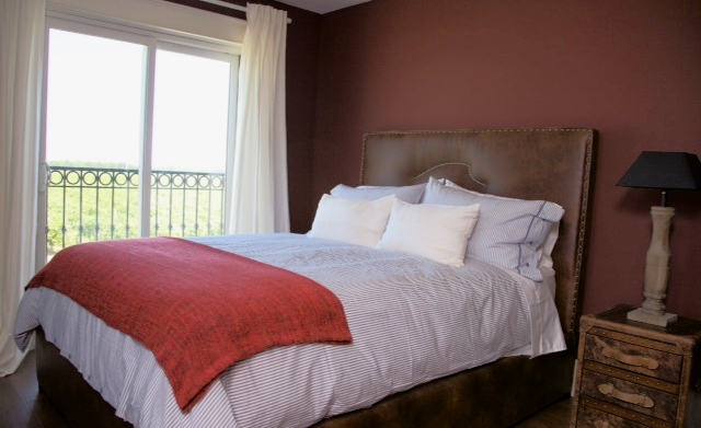Beautifully appointed room with a romantic Juliet balcony overlooking our vineyards on our Estate property.