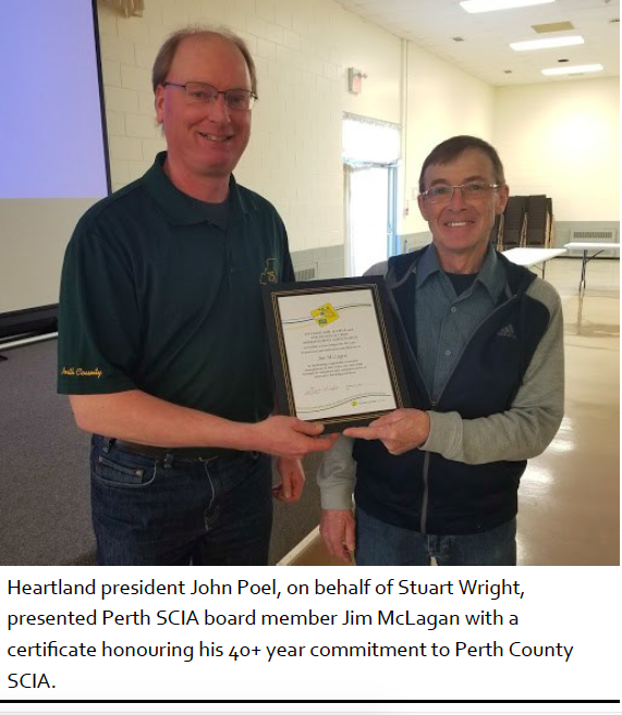 Heartland president John Poel, on behalf of Stuart Wright, presented Perth SCIA board member Jim McLagan with a certificate honouring his 40+ year commitment to Perth County SCIA.
