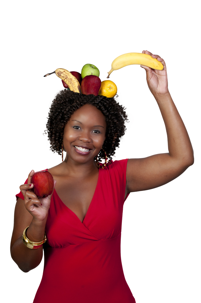 Woman with fruit on her head.