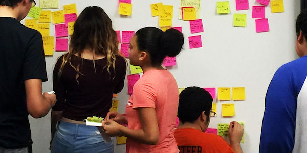 People working on a co-design project with sticky notes
