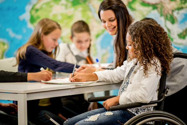 Girl in wheelchair with teacher