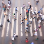 Large group of people crossing in crosswalk