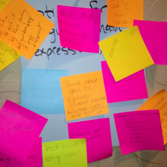 Image of sticky notes with writing on them from August Institute