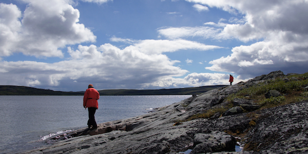 John Ketchum and Jesse Reimink investigate shoreline outcrops along Point Lake during a fairly cold day on the water. Photo by Rick Carlson, DTM.