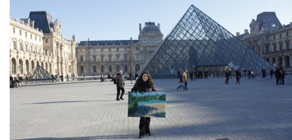 Donna Grandin with painting in front of Louvre in Paris