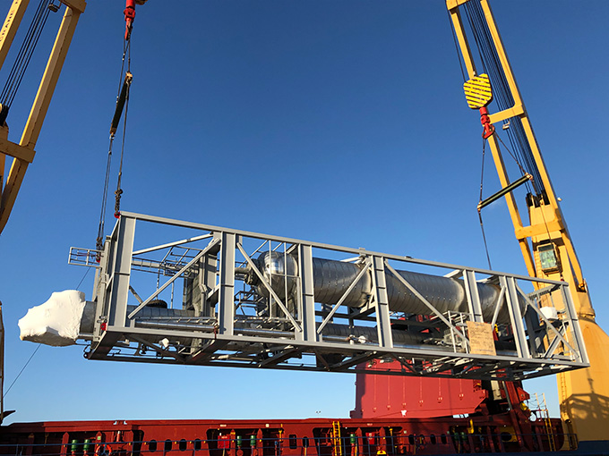 A picture containing sky, outdoor, train, crane  Description automatically generated