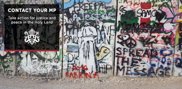 Separation Wall with image of Pope Francis praying