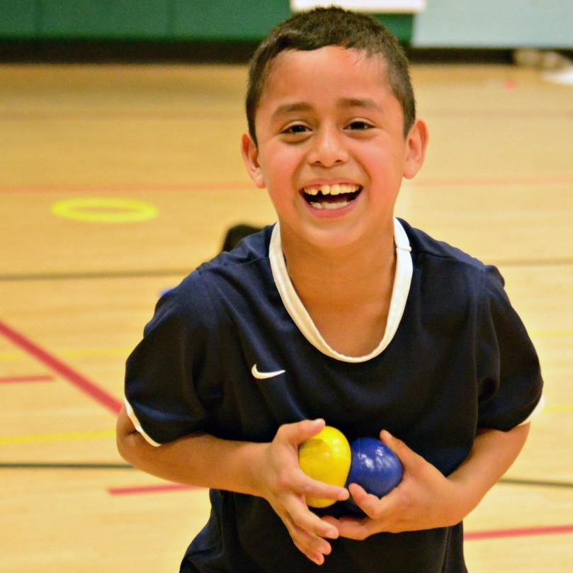 Student smiling after juggling