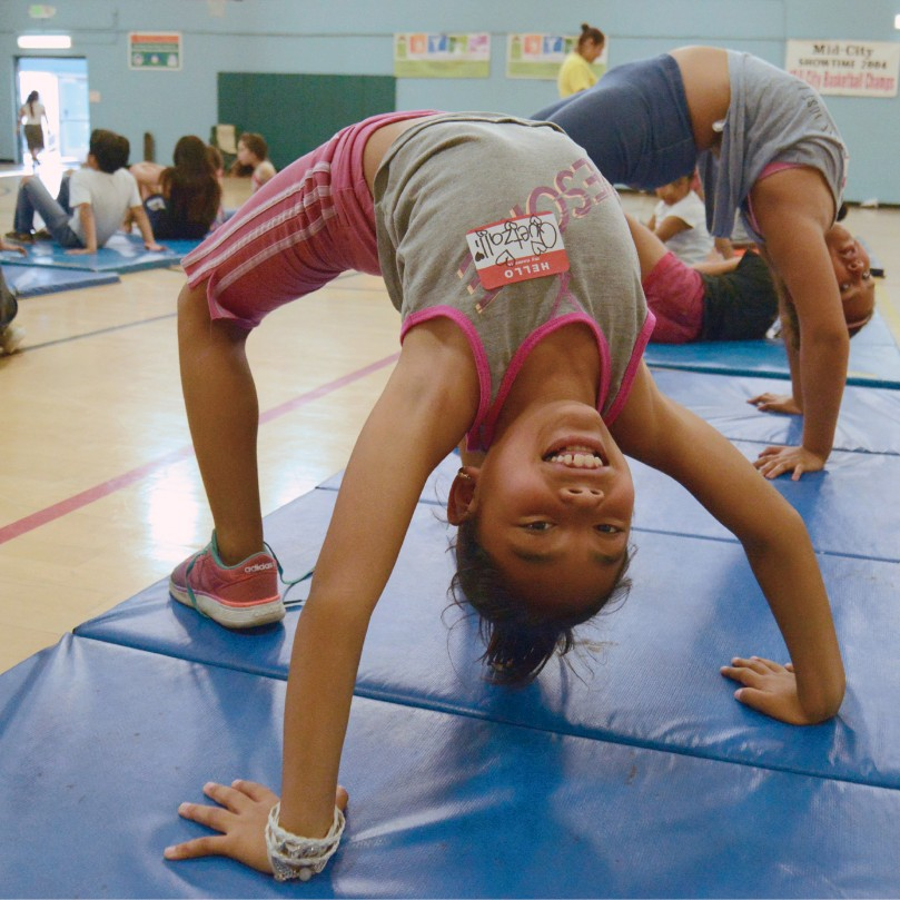 Students practicing acrobats