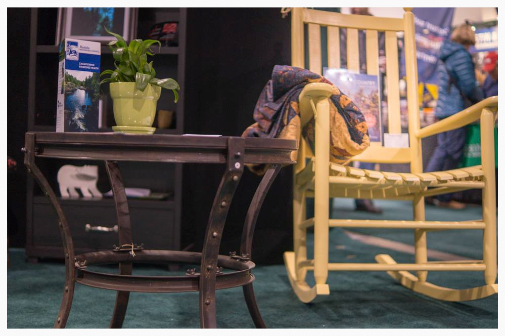 Furniture provided by Simply Cottage gave the MWC booth a rustic feel.