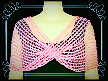 The pink sequined silk Mesmer Veil styled as a moebius.