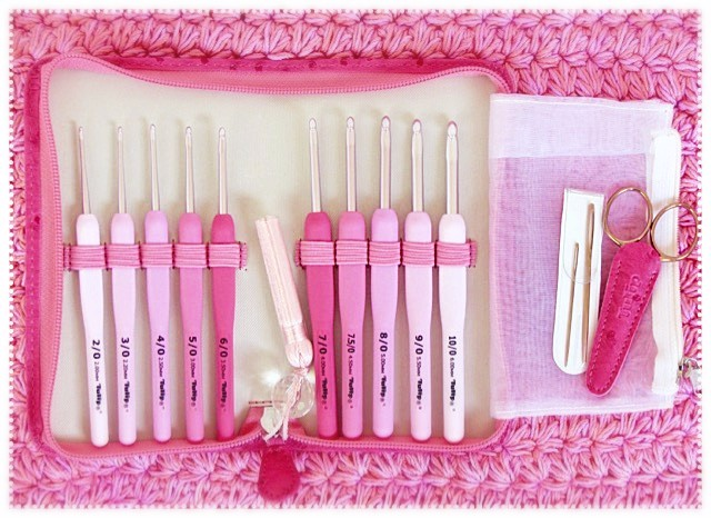 Tulip Co.'s deluxe Etimo Rose-colored crochet hook set (pink crochet background)
