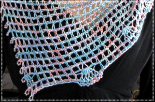 Link goes to the Ravelry project page for Seshen (beaded silk Tunisian net design in progress)